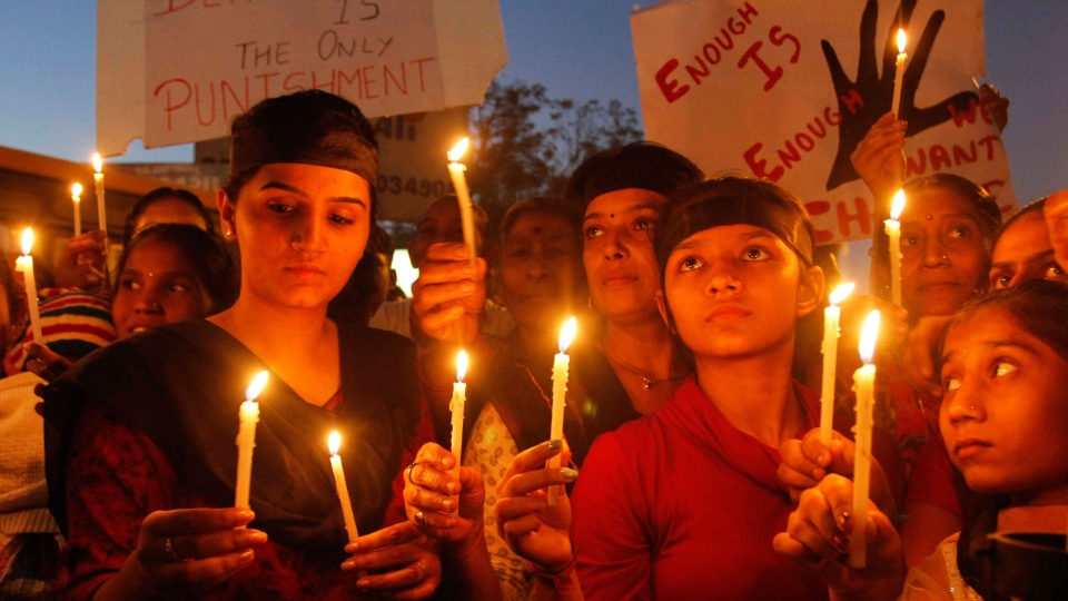 Indians holds candles to condemn the brutal gang-rape of a woman on a bus in New Delhi, during a protest in Ahmadabad, India, Monday, Dec. 24, 2012. (AP / Ajit Solanki)