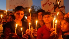 Indians holds candles to condemn the rape