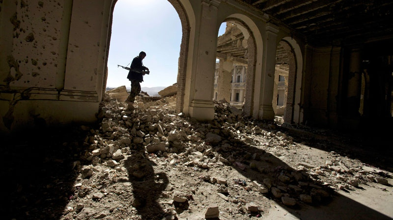 An Afgan national Army soldier walks throgh the ruins of the royal palace, also knows as Afghan president Hafizullah Amin's palace at Kabul seen after decades of war in Afghanistan, Sunday, Dec. 5, 2010. (AP / Alexander Zemlianichenko)
