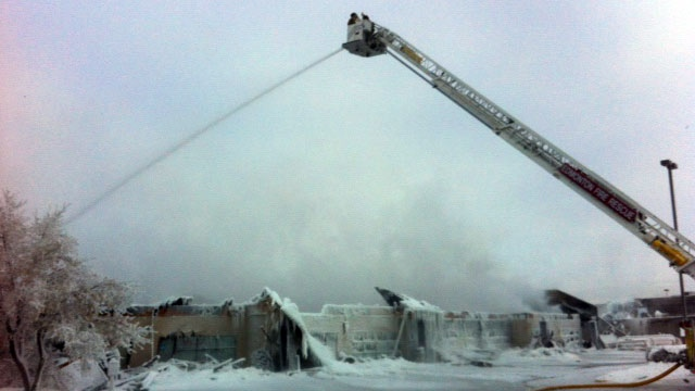 Edmonton firefighters put out a blaze that damaged eight businesses in Edmonton's north end on Tuesday, Dec. 25, 2012.