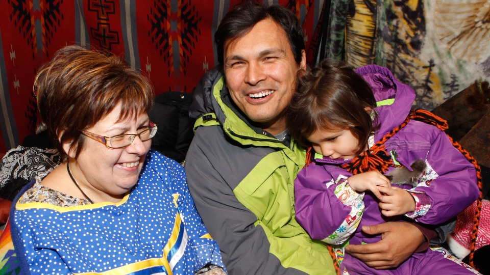 Attawapiskat Chief Theresa Spence talks with her family and Native American actor Adam Beach and daughter Phoenix Beach as she continues her hunger strike in a teepee on Victoria Island in Ottawa, early Tuesday, Dec. 25, 2012. (Cole Burston / THE CANADIAN PRESS)