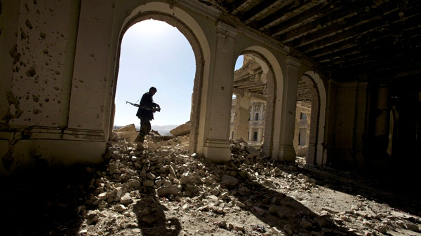 An Afghan National Army soldier walks through the ruins of the royal palace, also knows as Afghan president Hafizullah Amin�s palace, in Kabul, Afghanistan, Sunday, Dec. 5, 2010. (AP / Alexander Zemlianichenko)