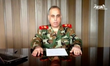 Head of Syria's military police defects