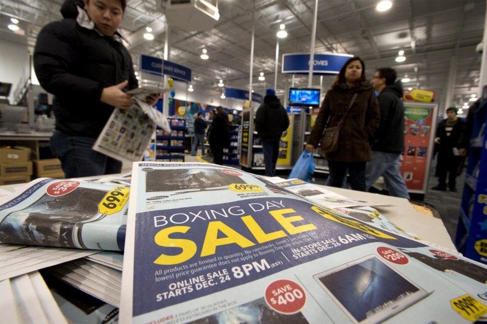 Shoppers hunt for early morning Boxing Day bargains at a suburban electronics store in Toronto on Wednesday December 26, 2012. (THE CANADIAN PRESS/Frank Gunn)