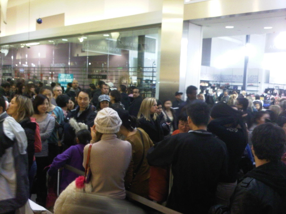 Dozens of shoppers at Vaughan Mills shopping centre north of Toronto lined up for one hour to get 15 per cent off Michael Kors merchandise. (Naomi Parness/CTV Toronto)
