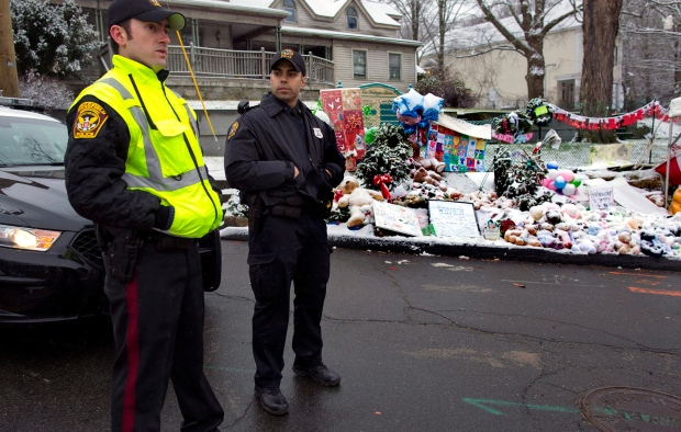 Officers stand near Newtown memorial Dec. 25, 2012