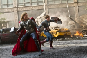 In this publicity film image released by Disney, Chris Hemsworth portrays Thor, left, and and Chris Evans portrays Captain America, in a scene from 'The Avengers.' (AP Photo/Disney/Zade Rosenthal)