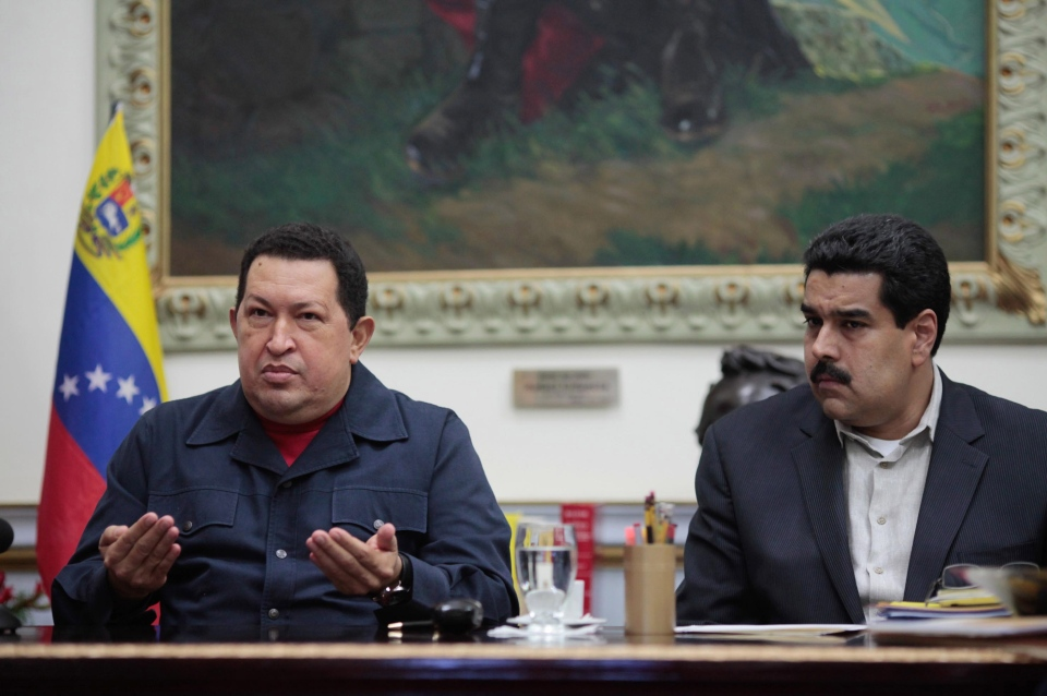 Venezuela's President Hugo Chavez, left, speaks beside his Vice President Nicolas Maduro during a televised speech form his office at the Miraflores presidential palace in Caracas, Venezuela on Dec. 8, 2012. (Miraflores Press Office, Marcelo Garcia)