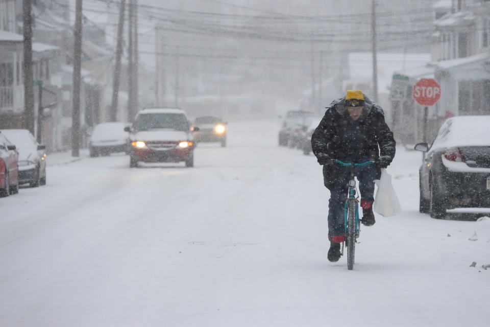 James Hill, of Shamokin, Pa., rides his bicycle in Coal Township, Pa. through the snow on Wednesday, Dec. 26, 2012. The storm is making its way to Ontario. (AP/The News-Item, Larry Deklinski)