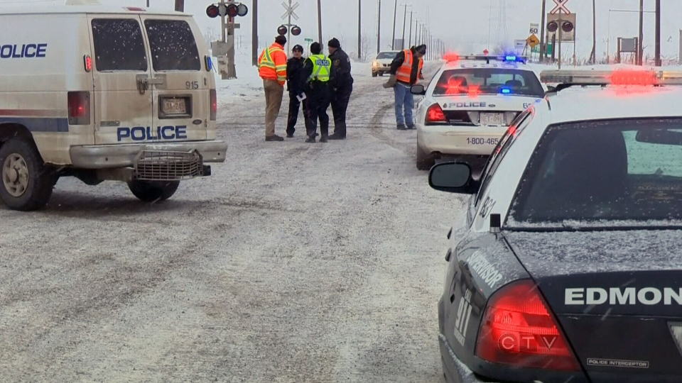 Edmonton police attended to the scene where three rail workers were struck by a train in the Cloverbar yard in Edmonton on Wednesday, Dec. 26, 2012.