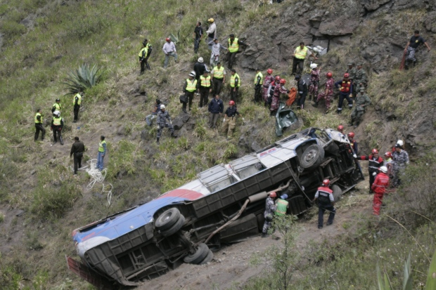 Rescuers at a crashed bus in Ecuador Dec. 26, 2012