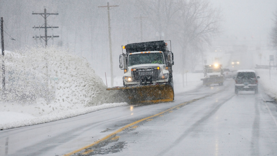 Kentucky Transportation Cabinet snowplows head south on U.S. 41 in Henderson, Ky. as blizzard conditions made travel difficult on Wednesday, Dec. 26, 2012. (AP / The Gleaner, Mike Lawrence)