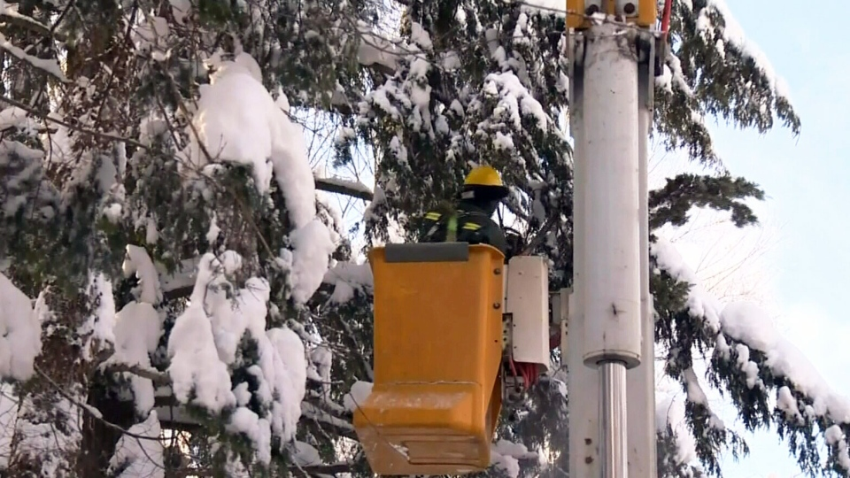 Hydro crews work to restore power to homes in Ste-Agathe, Quebec on Wednesday, Dec. 26, 2012.