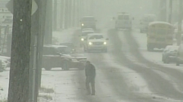 Cars drive as heavy snow falls in Windsor, Ont. on Wednesday, Dec. 26, 2012.