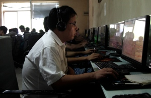 A Chinese man uses a computer at an Internet cafe in Beijing,  July 14, 2010. (AP / Ng Han Guan)