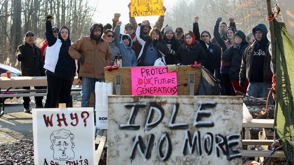 People from Aamjiwnaang First Nation and supporters gather for a meeting with officials as their blockade of the CN St. Clair spur line that began Friday, continues in Sarnia, Ont., Sunday, Dec. 23, 2012. (Dave Chidley / THE CANADIAN PRESS)