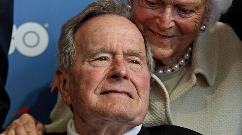 Former U.S. President George H.W. Bush and his wife, Barbara, arrive for the premiere of HBO's new documentary about his life in Kennebunkport, Maine, June 12, 2012.  (AP / Charles Krupa, File)