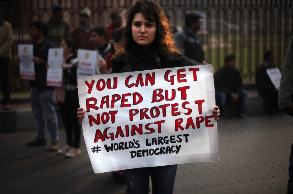 An Indian protester holds a placard during a protest against a recent gang rape of a young woman in a moving bus in New Delhi, India, Thursday, Dec. 27, 2012. (AP / Altaf Qadri)