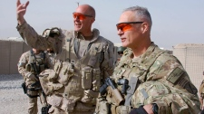 Canadian Brig.-Gen. Dean Milner (left) gestures as U.S. Maj.-Gen. James Terry looks on in Folad, Afghanistan, Monday, Dec. 6, 2010. Canadian troops officially took control of the long-standing insurgent redoubt of Zangabad, southwest of Kandahar city Monday, but Terry, the commander of NATO forces in southern Afghanistan, said he doesn't expect the Taliban to simply melt away. (Murray Brewster / THE CANADIAN PRESS)
