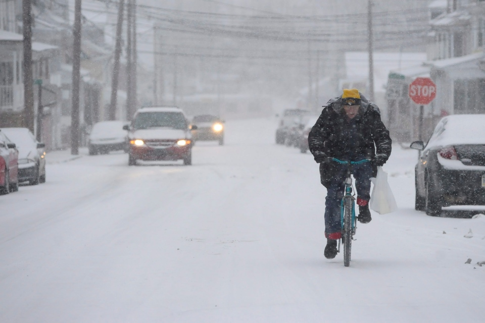 James Hill, of Shamokin, Pa., rides his bicycle in Coal Township, Pa. through the snow on Wednesday, Dec. 26, 2012. (AP / The News-Item, Larry Deklinski)