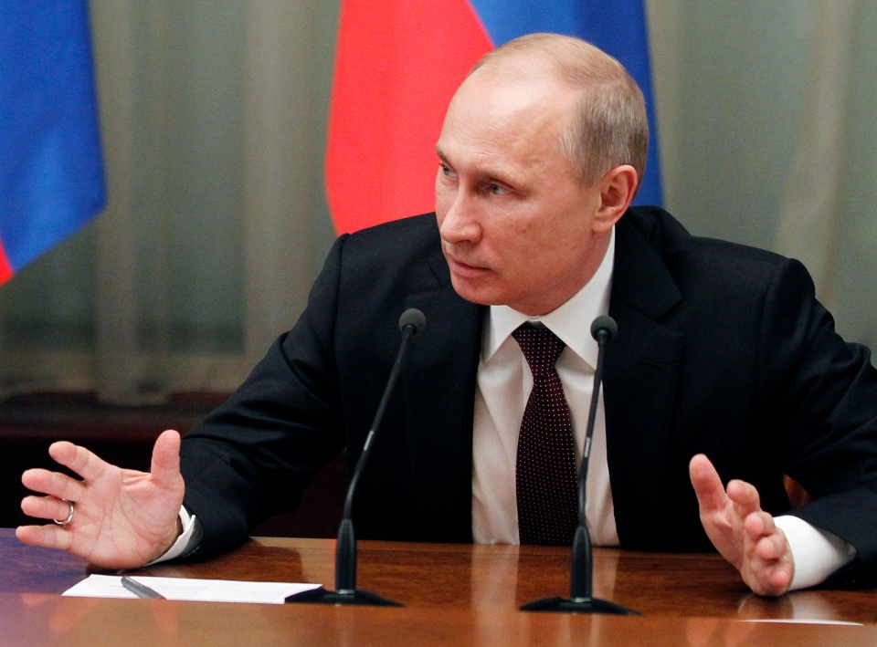 Russian President Vladimir Putin speaks at the final Cabinet meeting of the year in the government headquarters in Moscow, Thursday, Dec. 27, 2012. (Novosti, Dmitry Astakhov / Government Press Service)