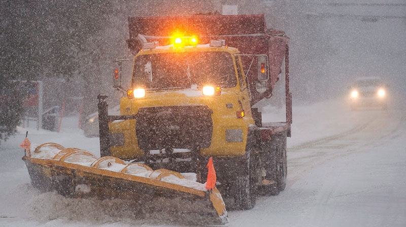 A snow removal truck clears a road near Montreal Thursday, Dec. 27, 2012 during the first major snowstorm of winter in the region. (Graham Hughes /THE CANADIAN PRESS)