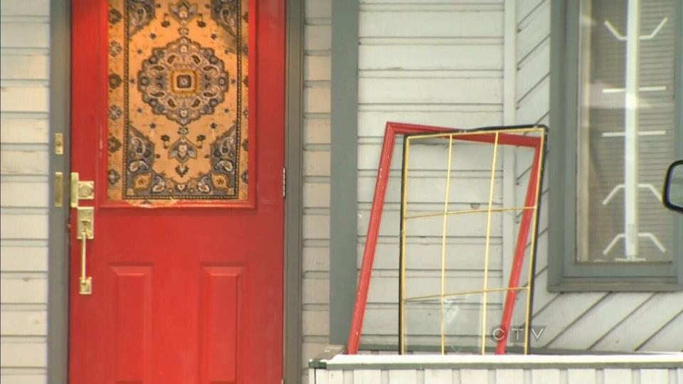 A broken door is seen after a home invasion in Calgary on Wednesday, Dec. 27, 2012.