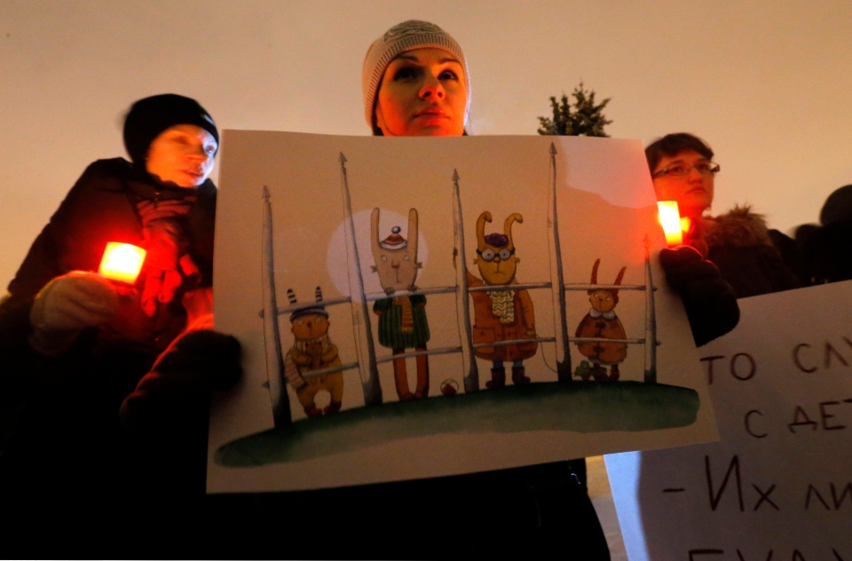 Opposition activists protest against a bill banning U.S. adoptions of Russian children in St.Petersburg, Russia, Wednesday, Dec. 26, 2012. (AP / Dmitry Lovetsky)