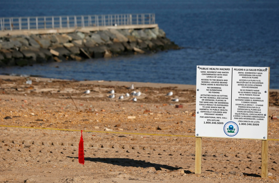 A sign warns people to keep off the waterfront area because of high levels of lead that were recorded following Superstorm Sandy in Laurence Harbor, N.J., Thursday, Dec. 13, 2012. (AP / Julio Cortez)