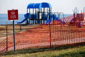 A recreational area is fenced off in an area where high levels of lead were recorded following Superstorm Sandy in Laurence Harbor, N.J., Thursday, Dec. 13, 2012. (AP / Julio Cortez)