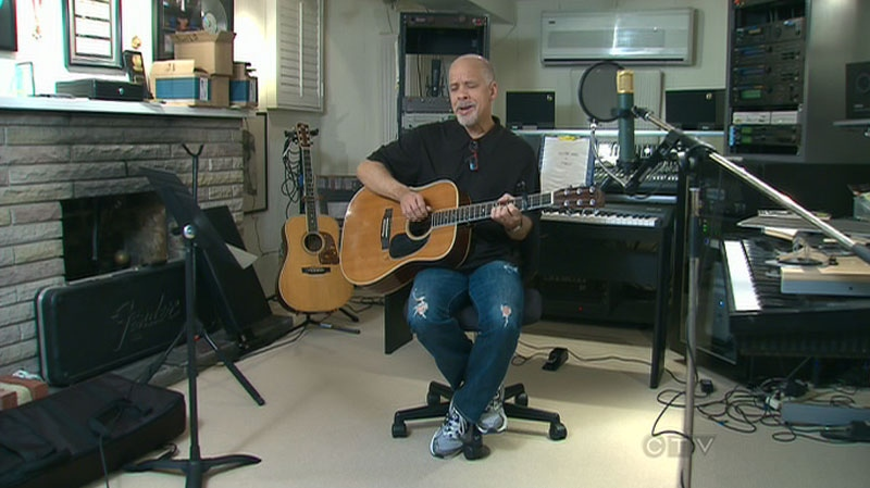Musician Dan Hill is seen playing music in his Toronto home in this undated photo.