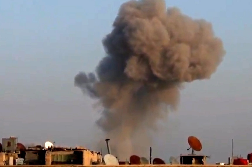 Smoke rises from buildings from heavy shelling in Damascus, Syria, on Thursday, Dec. 27, 2012. (AP / Shaam News Network via AP video)