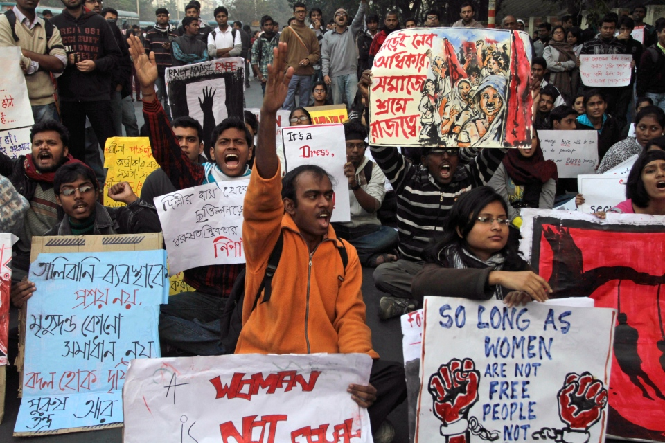 Indian students protesting against a recent gang-rape of a young woman in a moving bus in New Delhi, rally in Kolkata, India, Thursday, Dec. 27, 2012. (AP / Bikas Das)