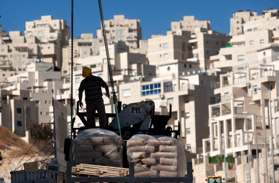 A construction worker works on a new housing unit in the east Jerusalem neighbourhood of Har Homa, Nov. 2, 2011. (AP / Sebastian Scheiner)
