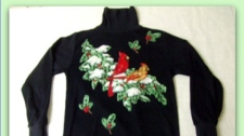 The $39.99 Joy Robbins features two festive robbins atop a decorative tree branch covered in snow. Four additional holiday leaves complete the ensemble. (Christmas Sweaters)