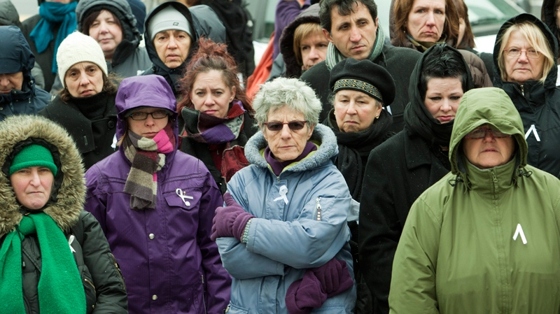 People take part in a vigil to commemorate the 14 women who were slain at the University of Montreal 21 years ago, Monday, Dec. 6, 2010. (Ryan Remiorz / THE CANADIAN PRESS)
