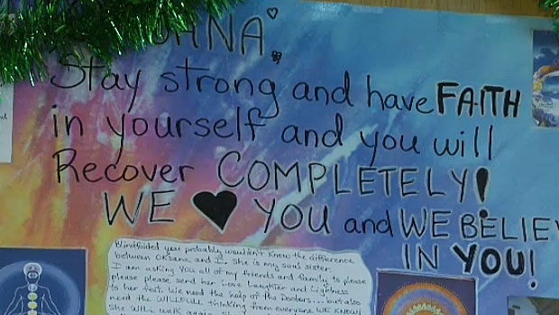 A poster hangs in Oksana Izio's room at the Glenrose Rehabilitation Hospital. Izio is choosing to have a positive outlook on a difficult situation - she is paralyzed from the shoulders down but is beginning to regain some feeling in her body.