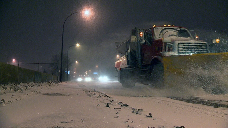 A snowplow shifts record amounts of snow to the side of the road in Montreal, Thursday, Dec. 27, 2012.