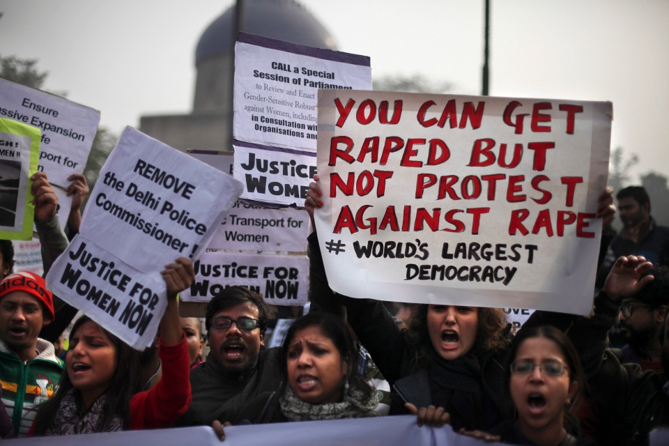 Indian protesters hold placards as they protest against a recent gang-rape of a young woman in a moving bus in New Delhi, India, Thursday, Dec. 27, 2012. (AP / Altaf Qadri)