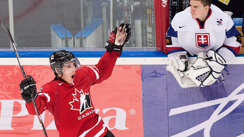 Canada forward Ryan Strome, left, reacts next to Slovakia back up goalie Patrik Romancik, right, after scoring a goal during third period IIHF World Junior Championships hockey action in Ufa, Russia on Friday, Dec. 28, 2012. (Nathan Denette / THE CANADIAN PRESS)