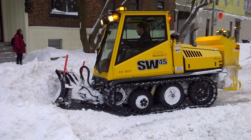 Snow-clearance crews were hard at work Thursday morning, including this little sidewalk-clearing unit at Grand and Sherbrooke. (Image CTV Cosmo Santamaria).