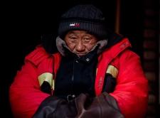 Elderly street worker