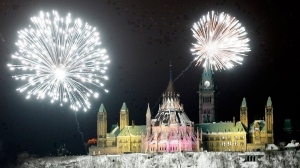A New Year's Eve fireworks show called 'The Grand Finale' is set off on the edge of the Ottawa River bellow Parliament Hill in Ottawa on Monday Dec. 31, 2007. (Sean Kilpatrick / THE CANADIAN PRESS)