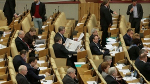 Russian lawmakers attend a session of the lower house of the State Duma in Moscow, Russia, Friday, Dec. 21, 2012. (AP / Mikhail Metzel)