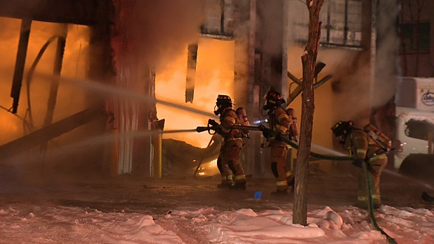 Fire officials are investigating the cause of a blaze that destroyed an auto repair shop Thursday.