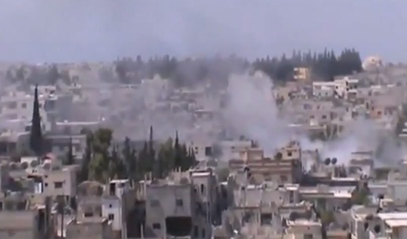 Smoke rises from buildings from heavy shelling in Homs, Syria, on Thursday, Dec. 27, 2012. (AP / Shaam News Network via AP video)