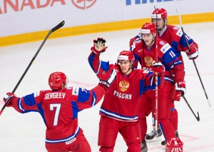 Russia forward Vladimir Tkachyov, centre, celebrates his game winning goal with Russian defenceman Artyom Sergeyev (7) and teammates while playing against team USA during third period IIHF World Junior Championships hockey action in Ufa, Russia on Friday, Dec. 28, 2012. (Nathan Denette / THE CANADIAN PRESS)