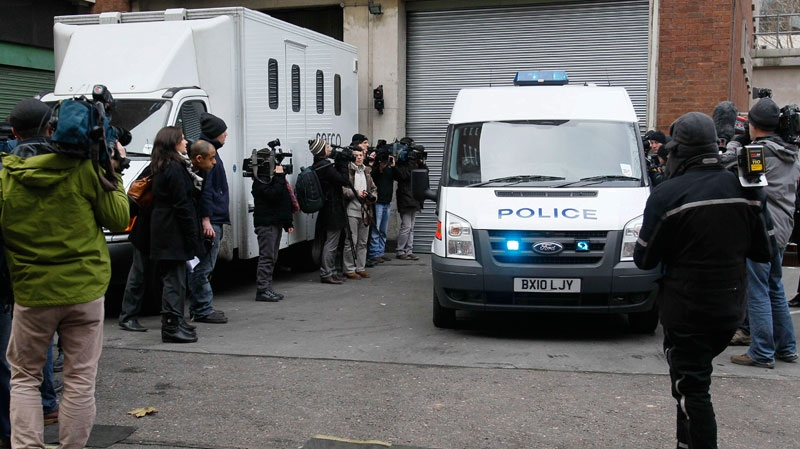 Members of the media gather outside the rear entrance of Westminster Magistrates Court in London, Tuesday, Dec. 7, 2010, where WikiLeaks founder Julian Assange is scheduled appear on an extradition warrant.  (AP / Kirsty Wigglesworth)