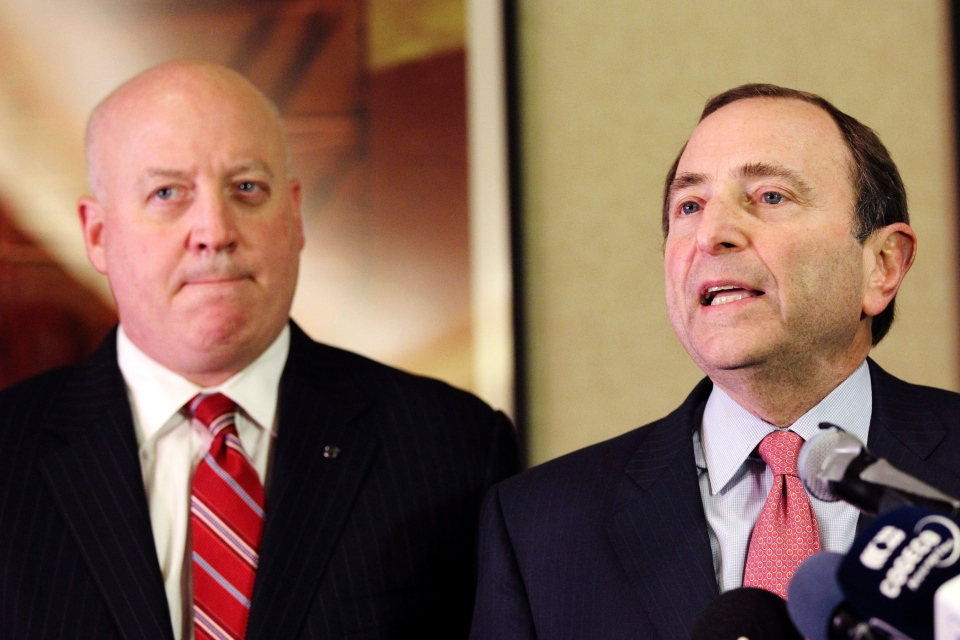 NHL Commissioner Gary Bettman, right, and deputy commissioner Bill Daly speak to reporters in New York, Thursday, Dec. 6, 2012. (AP / Mary Altaffer)