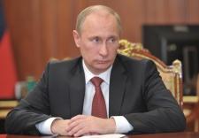 Putin signs U.S. adoption ban